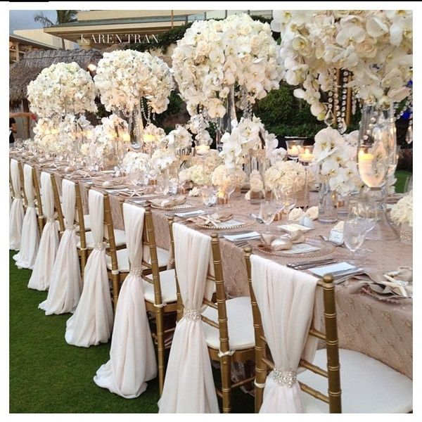 Beautiful centerpieces, chair back decor and wedding reception