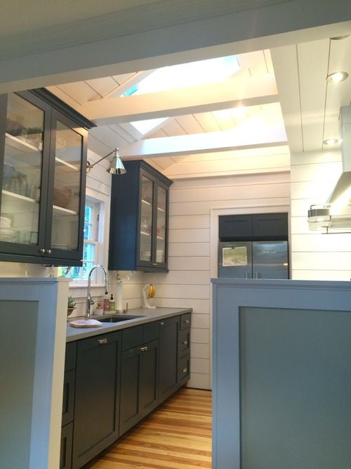Vaulted Ceiling Shiplap Kitchen With Quartz Countertops