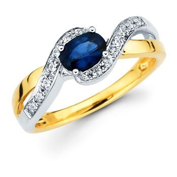 Lovely Oval Sapphire Ring with Sparkling Diamonds set in 14k White and Yellow Gold.  September birth stone:sapphire.