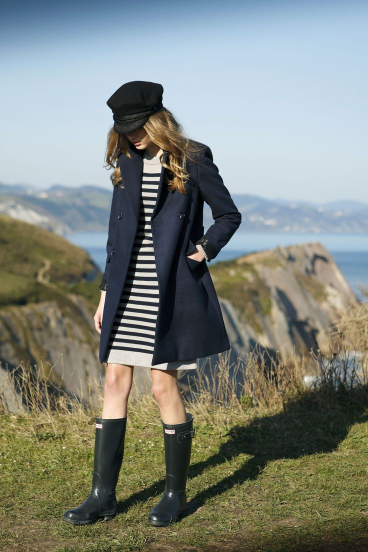 Dark navy blue jacket by Indi & Cold, styled with a striped blue and white jumper dress.