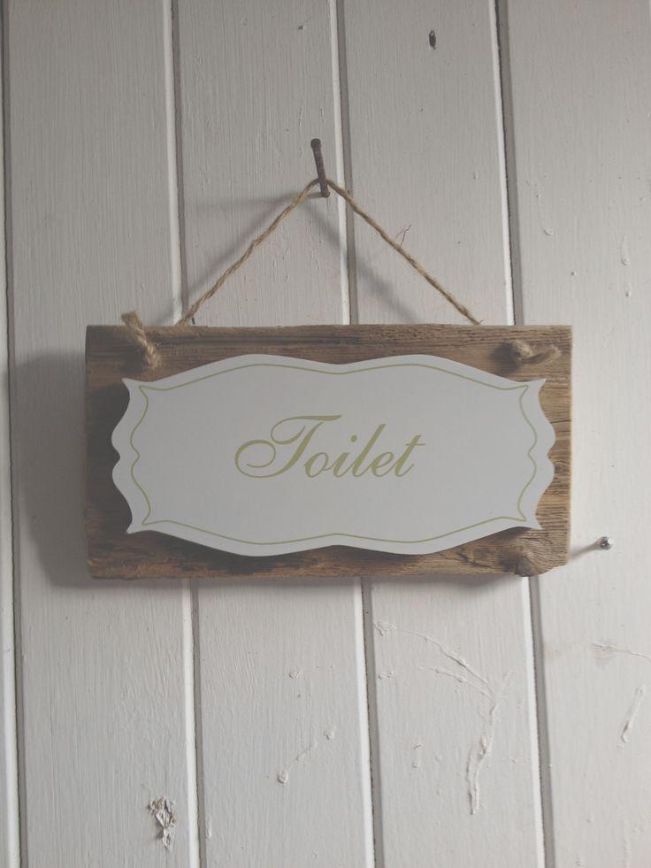 Wooden toilet sign