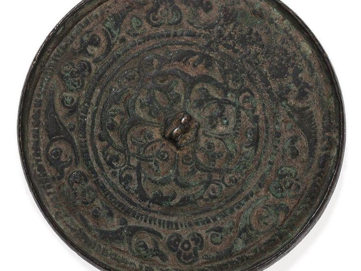 Bronze Mirror with Arabesque Decor, Khorasan, 12th/13th  Sold for  € 867.00
