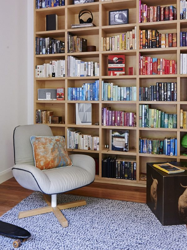 The Design Files | ArchiBlox custom built plywood bookshelf. Winston chair by Jardan, with Lumiere Art + Co cushion. Cockatoo box by Bonnie and Neil, rug by Ikea.