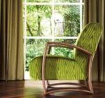 Groene gordijnstof waarmee je ook meubels kan (laten) bekleden.