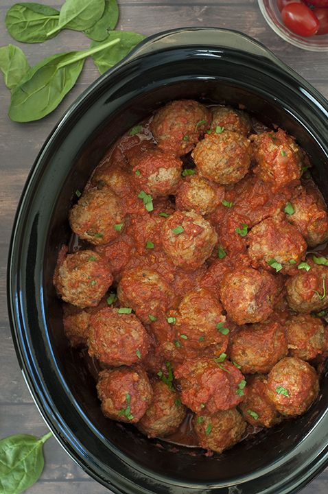 Quick and Easy Slow Cooker/Crock Pot Italian Meatballs packed with Parmesan cheese, fresh parsley and garlic in a delicious marinara sauce! They work well for dinner served over pasta, a holiday party appetizer or a potluck!