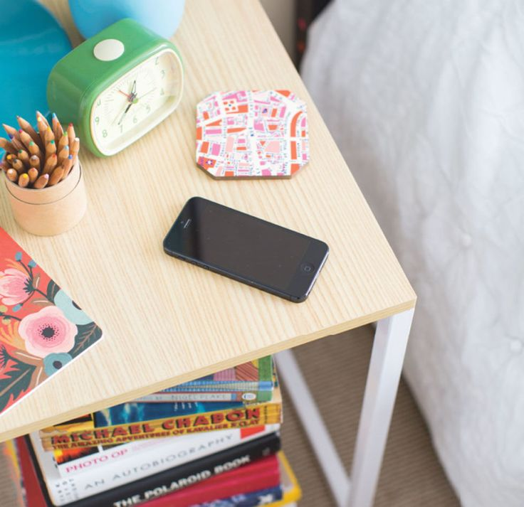 When you attach a futuristic charging mat to the bottom of your bedside table, you can charge your phone without even thinking about it — making it literally impossible to forget to plug in your device at night. Get the tutorial at Brit + Co »