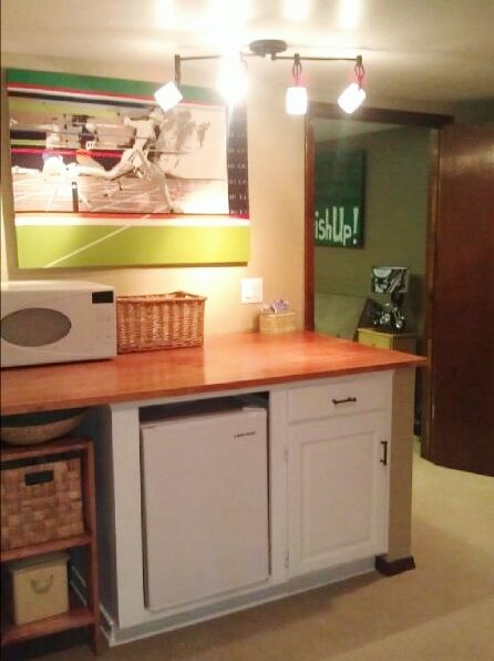 boys basement snack bar - used restore partial cabinet, built solid wood surface and changed light bulb fixture for track light