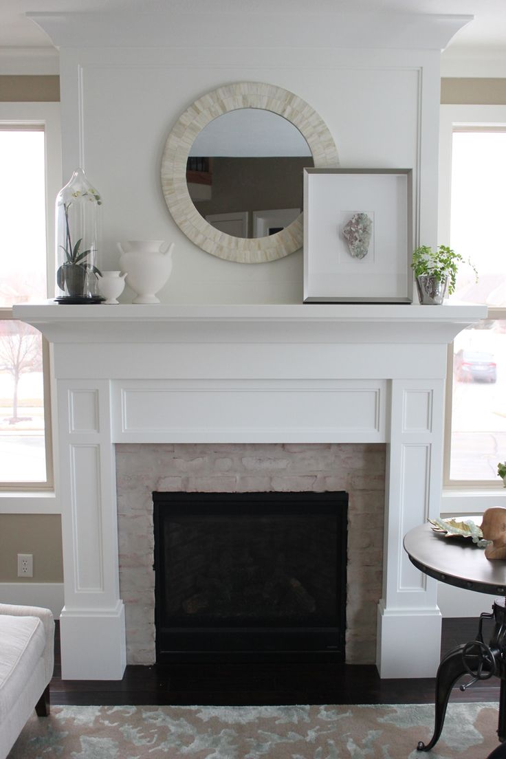 25 best ideas about fireplace between windows on - Does a living room need a fireplace ...