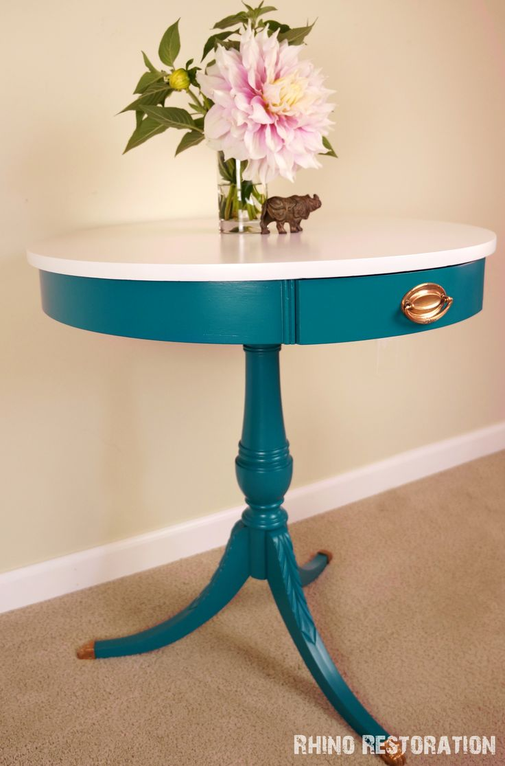 "Turquoise table painted ""Lagoon"" by Rustoleum with white top.  Smooth, satiny…"