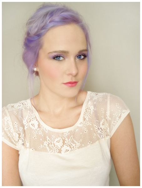 Lilac hair and pearl earrings.