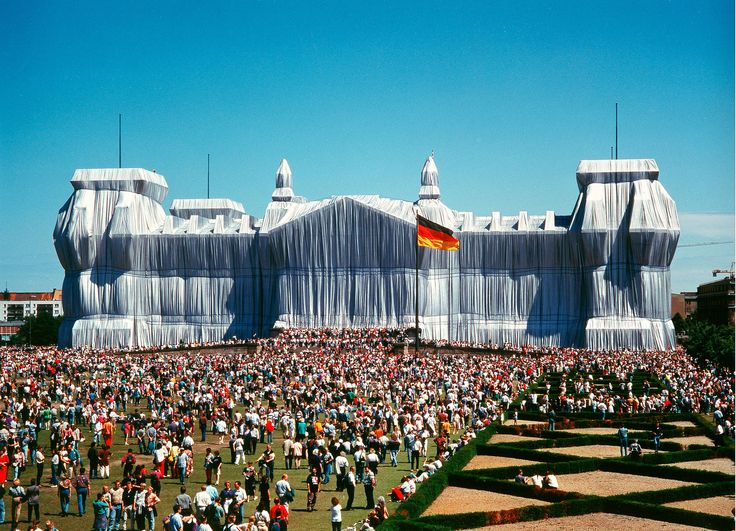 #Christo and Jeanne‑Claude Wrapped Reichstag (Project for West Berlin).  For a period of 2 weeks during June 1995, the richness of the silvery fabric, shaped by the blue ropes, created a sumptuous flow of vertical folds highlighting the features and proportions of the imposing structure, revealing the essence of the Reichstag.