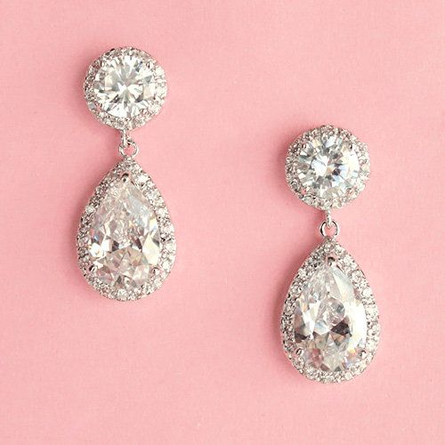 three pieces bridal jewelry  earrings bracelet and hair comb earrings