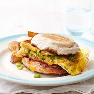 This egg sandwich recipe with flavorful Canadian bacon and crunchy bell pepper is a perfect healthy breakfast-for-dinner candidate.