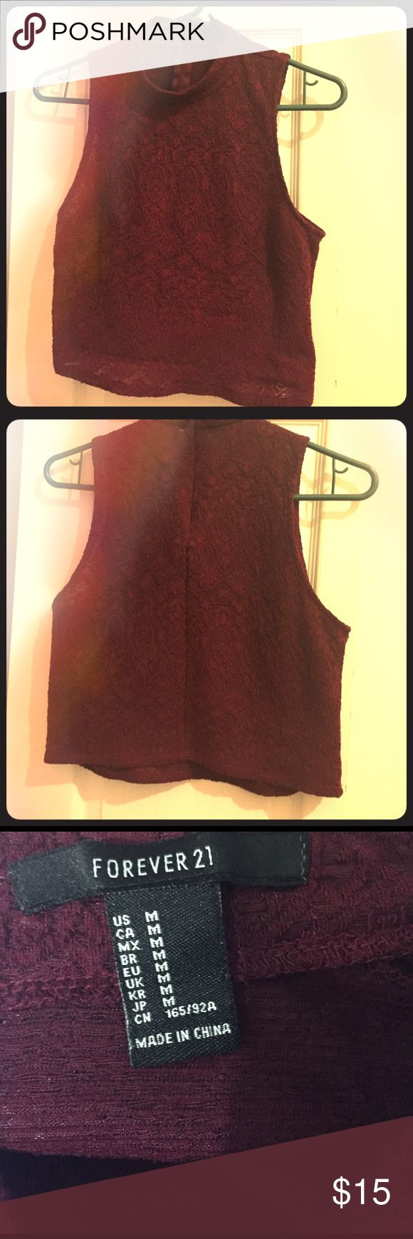 Magenta Forever 21 crop top Magenta short sleeve Forever 21 crop top with zipper in the back. Bought in 2014, but it is in very good condition. Size is medium. Forever 21 Tops Crop Tops