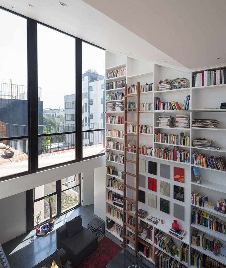 Double Story Vertical Bookshelves In A Contemporary House In Quintana Roo,  Mexico | Cadaval U0026
