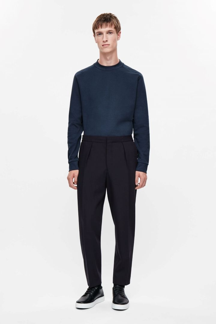 COS image 1 of Relaxed turn-up trousers in Dark Navy