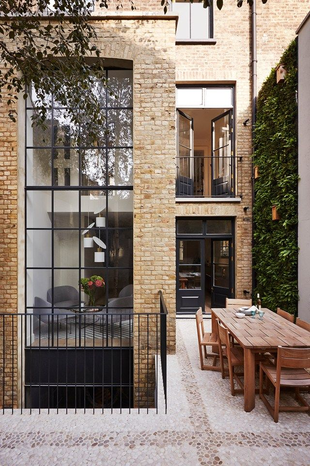 Green wall on the patio of a modern London townhouse renovation on @thouswellblog