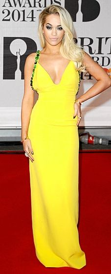 Rita Ora rocks a canary yellow Prada dress at the 2014 BRIT Awards