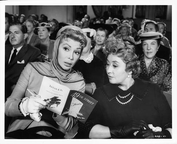 Dolores Gray and Joan Blondell take in a matinee to see their object of gossip in a scene from the film 'The Opposite Sex' 1956