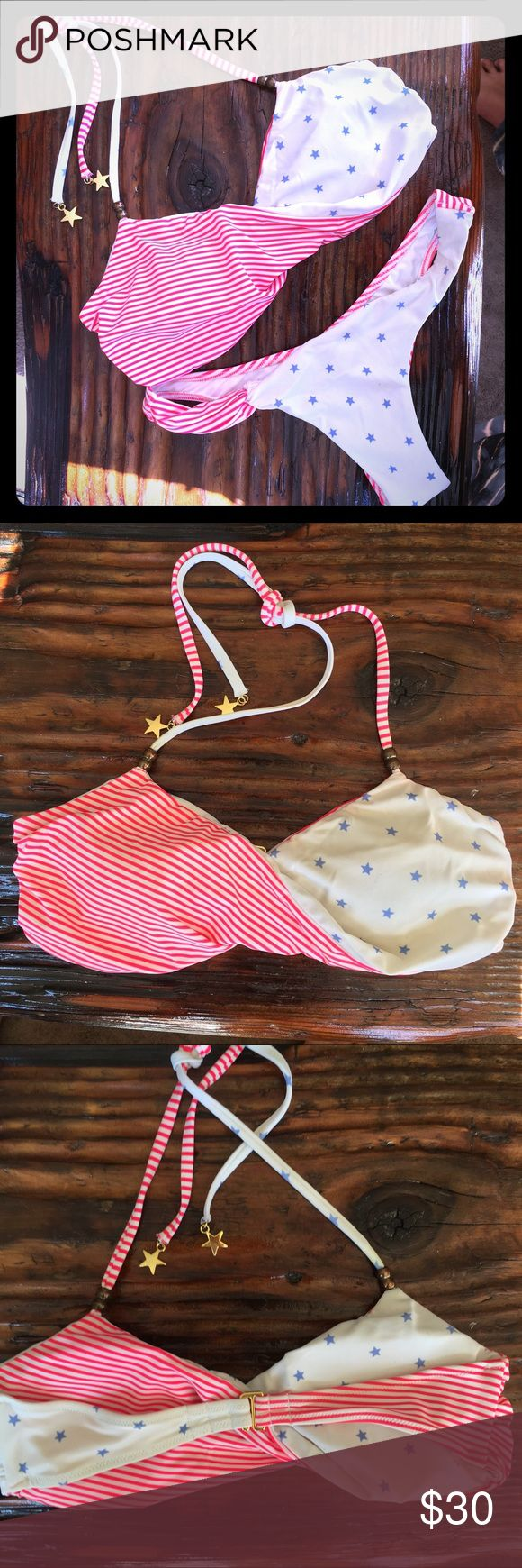 Victoria's Secret Bikini VS take on a Fourth of July American Flag bikini! Cute twist top wth removable padding. Adjustable clasp at the back and tie at neck with star charms. Hot pink stripe and light blue stars. Itsy bottoms with ruching. Small top and XS bottoms. Offers welcome! Victoria's Secret Swim Bikinis