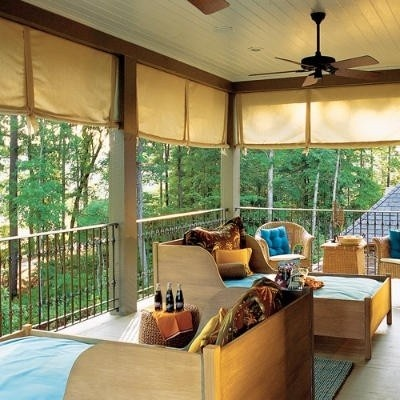 Sleeping porch with top-shades and ceiling fan. Cool and private when it needs to be