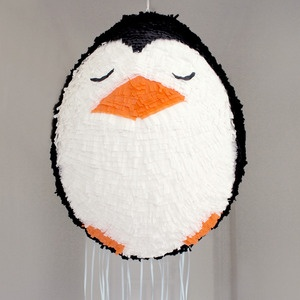 Penguin pinata--paper-mache a balloon, pop balloon when dry, and cover shell with tissue paper or paint. Cover hole with tape after filling. Easy!