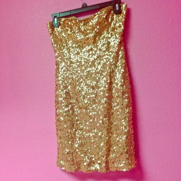 Gold sparkle dress Worn once very sparkly, it's short too not recommended for tall girls haha (: idk Dresses
