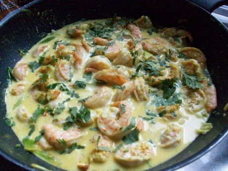 Scampi in curry saus met kokosmelk