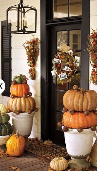 Love the pumpkins in the pots. Think I'll do that this fall in our urns
