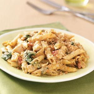 Pesto-Chicken Penne Casseroles ~  1 package (16 ounces) penne pasta  6 cups cubed cooked chicken  4 cups (16 ounces) shredded Italian cheese blend  3 cups fresh baby spinach  1 can (15 ounces) crushed tomatoes  1 jar (15 ounces) Alfredo sauce  1-1/2 cups 2% milk  1 jar (8.1 ounces) prepared pesto  1/2 cup seasoned bread crumbs  1/2 cup grated Parmesan cheese  1 tablespoon olive oil