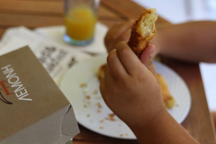 Our little friend, Dimitris, can't say no to a fresh, sweet-smelling, delectable Lemonis bakery croissant.