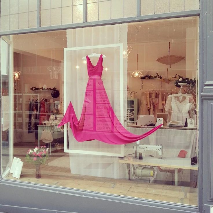 Here's one of our shop windows, pink bespoke dress by Redneck Clothing hung in a white frame.  November 2014.