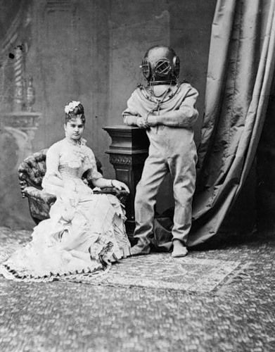 Vintage Photo of a Lady and man in deep sea diving suit...... A bit odd ....maybe it was his job?: