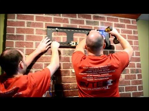 How To Hang a flat panel tv on a brick fireplace - YouTube