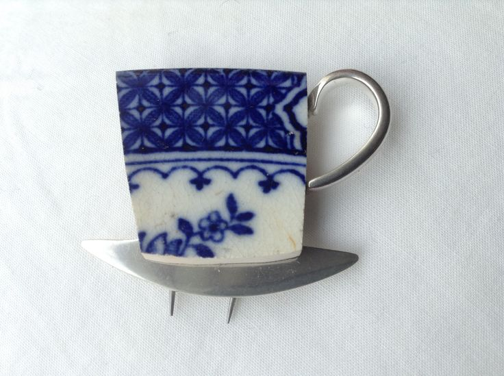 Tea cup and saucer brooch by Maggie Laing