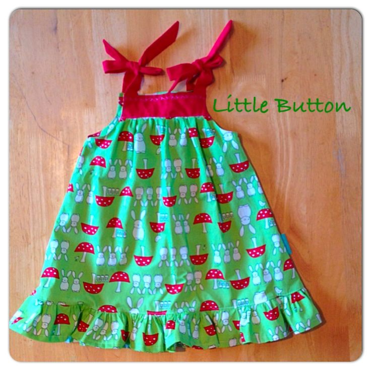 Girls sundress in green mushroom and bunnies cotton and red straps.