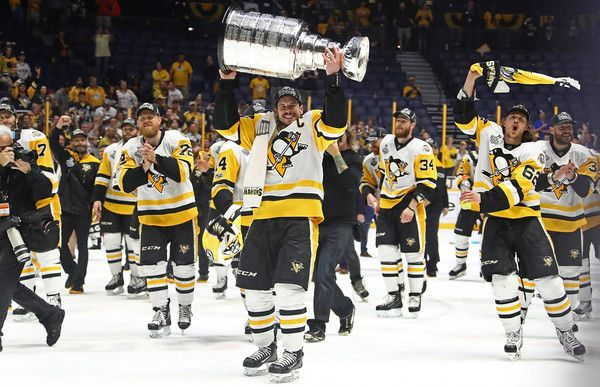 Sidney Crosby Photos - Sidney Crosby #87 of the Pittsburgh Penguins and his teammates celebrate with the Stanley Cup trophy after defeating the Nashville Predators 2-0 in Game Six of the 2017 NHL Stanley Cup Final at the Bridgestone Arena on June 11, 2017 in Nashville, Tennessee. - 2017 NHL Stanley Cup Final - Game Six