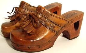 Clogs.  I had a pair nearly identical to these!  I can still remember the sound they made as I walked.