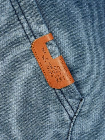 Textile, fabric, denim, pocket shirt, stitched, detail, leather, branding, label
