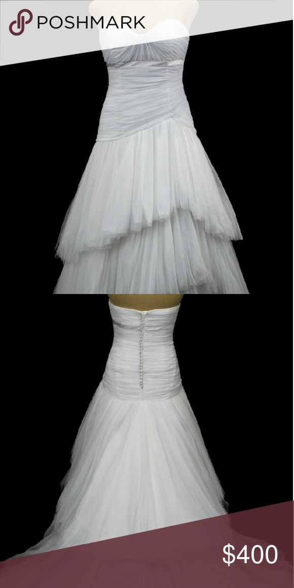 Anjolique wedding dress Sweetheart neckline dropped torso teared tulle skirt. Color white/silver. Not a used dress. Tried on in store only. Anjolique Bridal Dresses Wedding