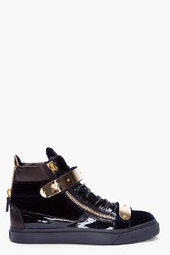 Giuseppe Zanotti Navy Velvet and Gold Sneakers for Men. High top velvet sneakers in navy with black patent leather contrasts. Round toe. Black lace up closure. Embroidered logo patch at padded tongue. Gold tone metal detail at velcro tabbed eyerow. Extended heel collar in metallic gold with exposed gold tone zipper closure. Gold tone exposed zipper detail at eyerow. Textured rubber foxing in black. Tone on tone stitching. Leather/textile upper, rubber sole. Made in Italy.