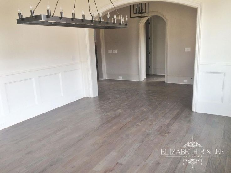 Minwax Classic Grey Stain on these dining Floors give the reclaimed Restoration hardware feel especially with the chandelier.
