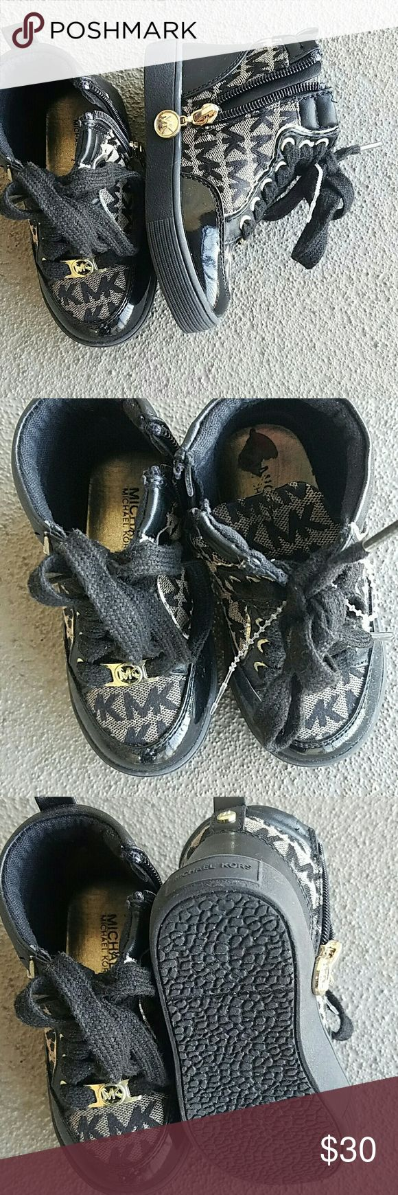 Michael Kors Toddler High Top Sneakers  Brand New Michael Kors Toddler High top sneakers Brand New. Side zipper for easy pull on. These are super cute. NWOT Michael Kors Shoes Sneakers