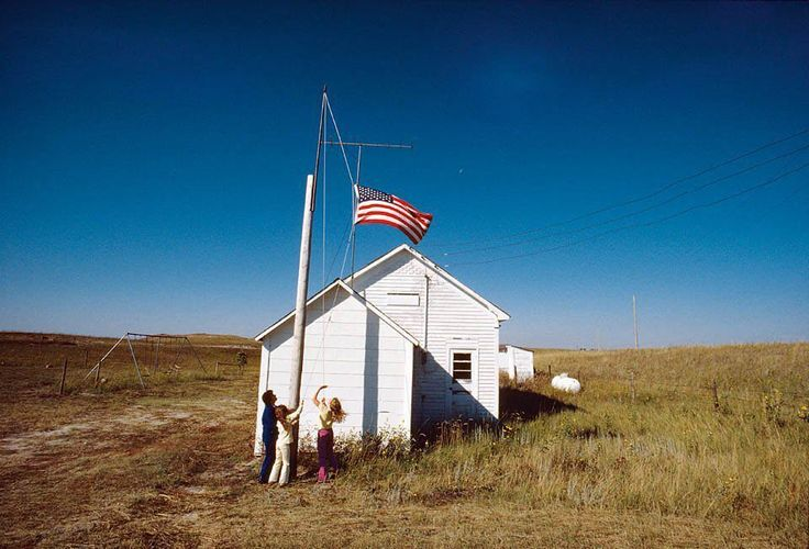 In Cherry County #Nebraska the day begins at School 100 with the raising of the flag by the schools lone teacher and its only two students. A #NationalGeographic Creative image featured in our new @natgeo #USA collection: tsc.hn/01164in