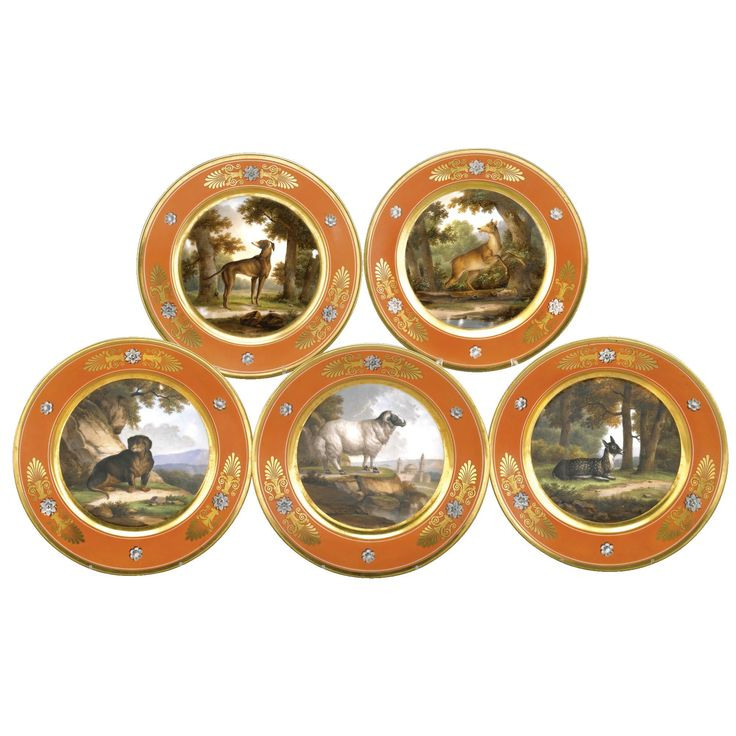 Five Nast Paris plates early 19th century  the centre of each finely painted with an animal in a wooden landscape, named on the reverse Le Lèvrier, La Biche, La Gazelle, Le Chien Baset and Le Belier de Tunis, within salmon-pink borders painted with palmettes in gilding alternating with grey-shaded flowers