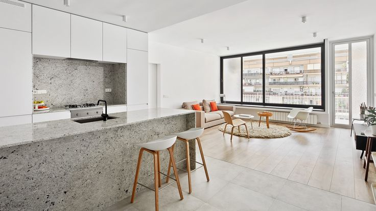 Spanish practice Raúl Sánchez Architects has employed contrasting materials to carve out different living zones in thisapartmentin Barcelona.