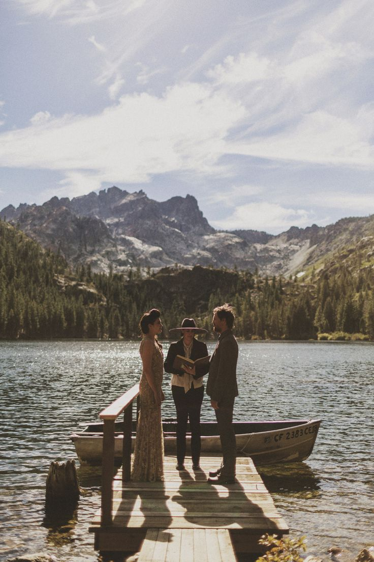 Love the simplicity of the lake side wedding