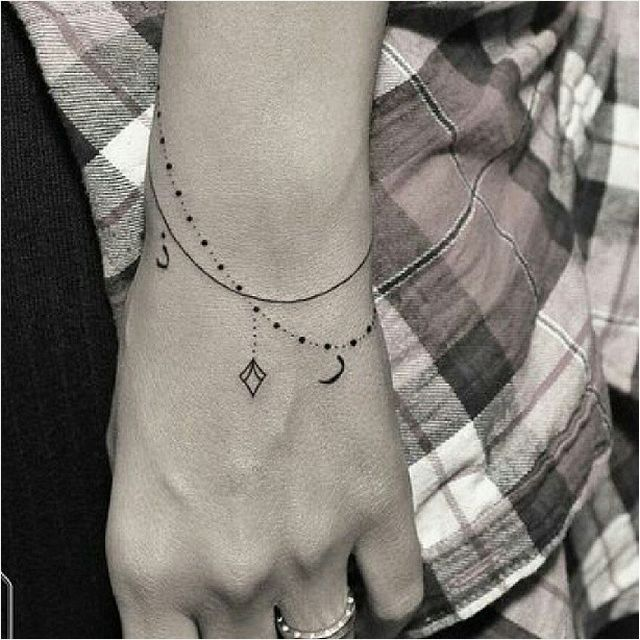 Love these dangling bracelets. 30 Tiny And Stunning Tattoos For Grown-Ups