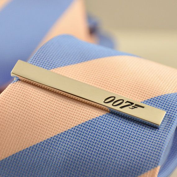 The 007 James Bond Tie Clip Silver Design with a Gift Box  Lightweight, fun and stylish to wear.  Tie Clip size: 60mm*7mm  QTY: 1 What a fun