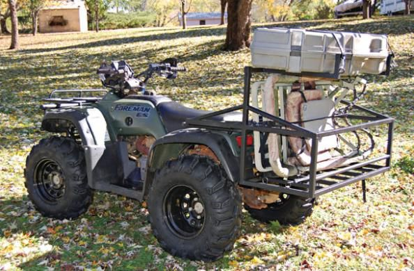 """Reader Project submitted by Chris Holdbrooks from Guntersville, ALPhoto courtesy of Chris Holdbrooks """"The width of the carrier is the same as the factory rack on my ATV [40 inches]. The basket is 12 inches off the ground, allowing plenty of clearance for steep approach angles, and the 22-inch-deep basket accommodates two climbing stands. """"The trusses [horizontal members] that run from front to back have a 3/16-inch plate welded to them for bolting to the factory rack. Two horizontal members…"""